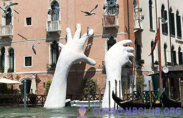 Composition: a pair of giant hands, rising out of the water